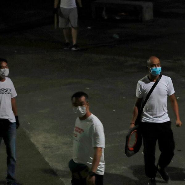 Masked men assault protesters