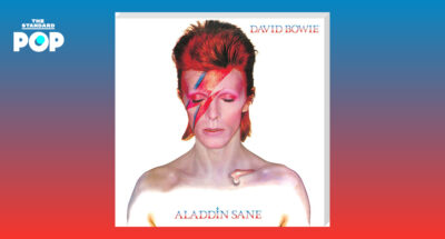 David Bowie with top naked body and red hair